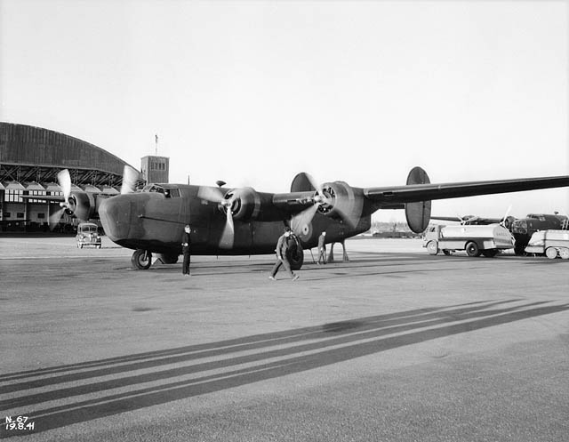 Lord Beaverbrook, the man who started the idea of ferrying aircraft out of Gander to the UK, arrives in Gander in a B24 to inspect RAF FC c.1943. A special moment in the history of Gander airport.