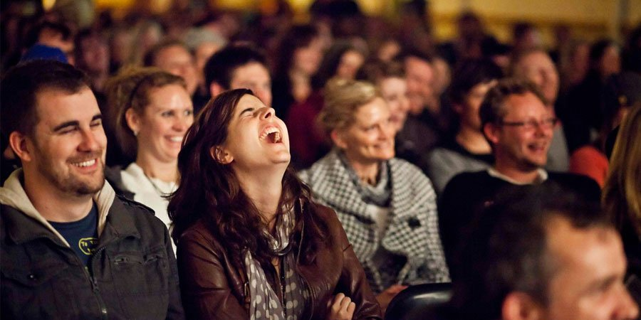 Image result for people laughing at comedy show