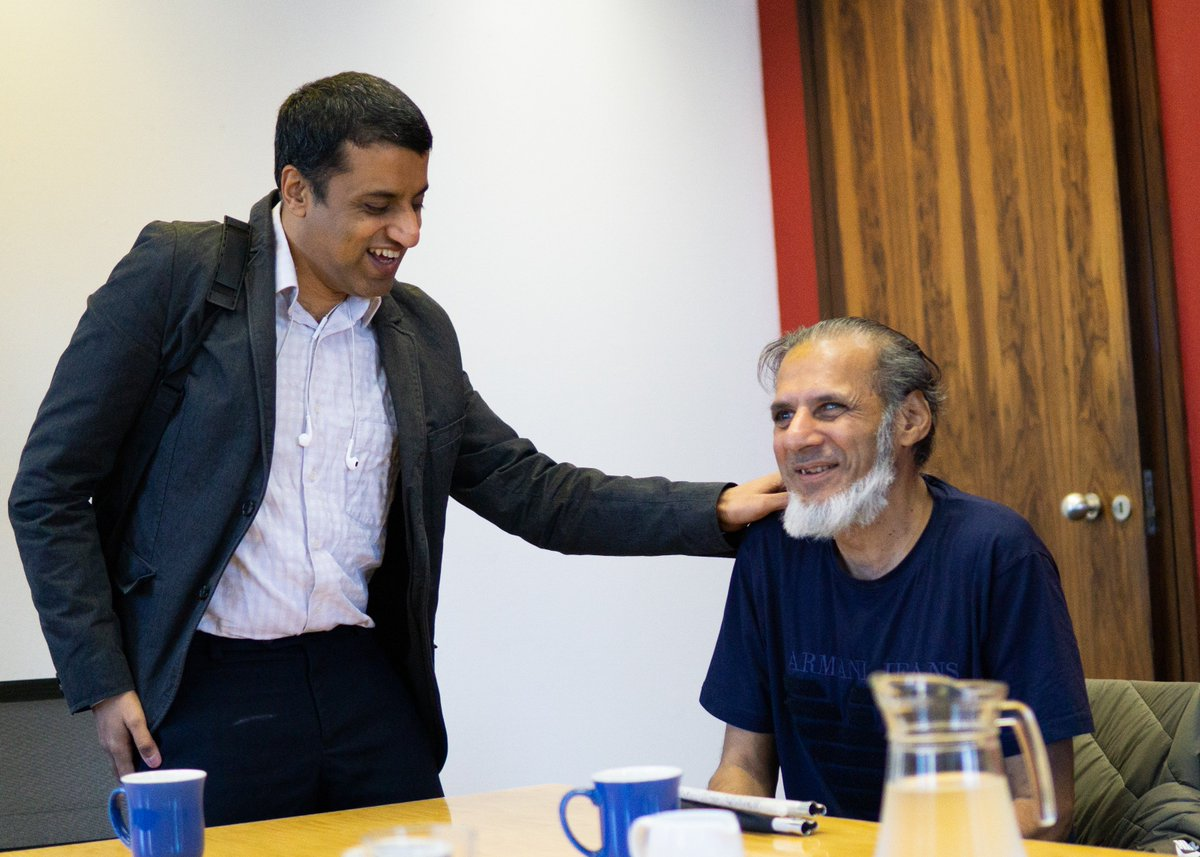 Image shows Hassan with service user Mujahid