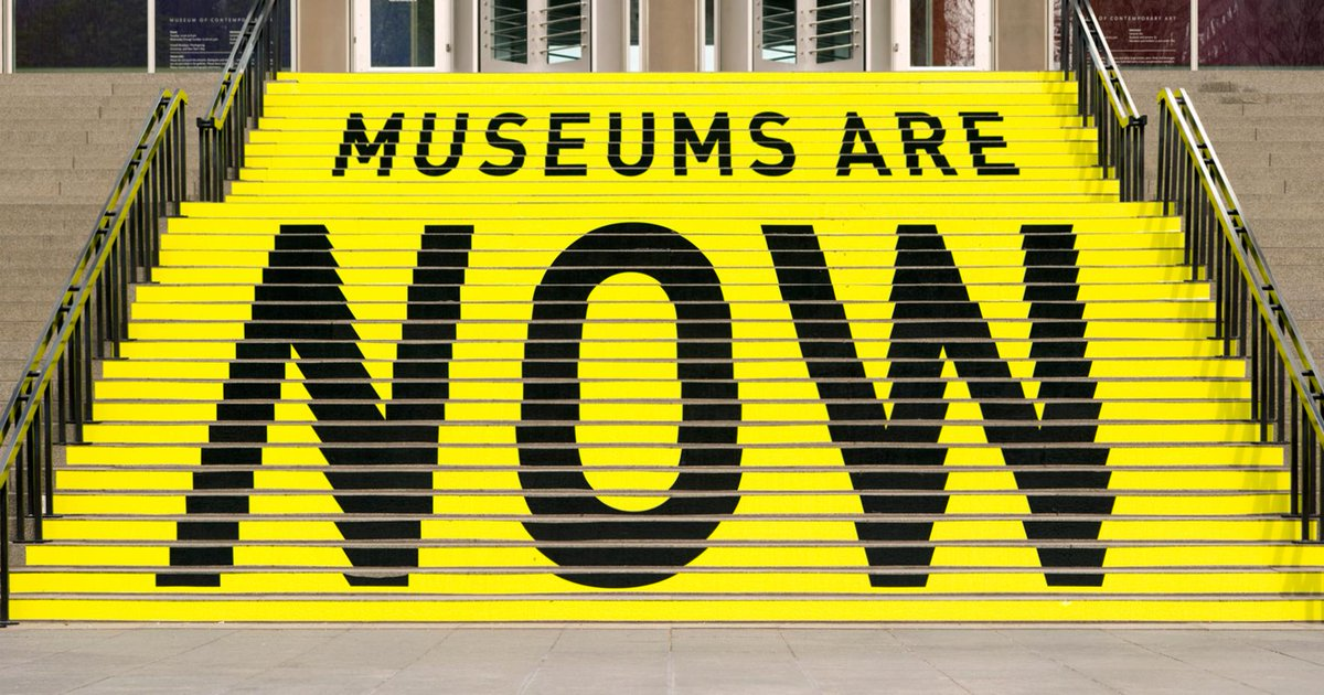 Stairs painted yellow and black that read Museums are NOW.