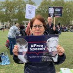 Cristina Navarrete, former Chilean political prisoner, today at the #FreeAssangeRally outside the Houses Of Parliament in London with designer @somersetbean's #FreeAssange #FreeManning posters. Downloads here: https://t.co/euod4X1lli