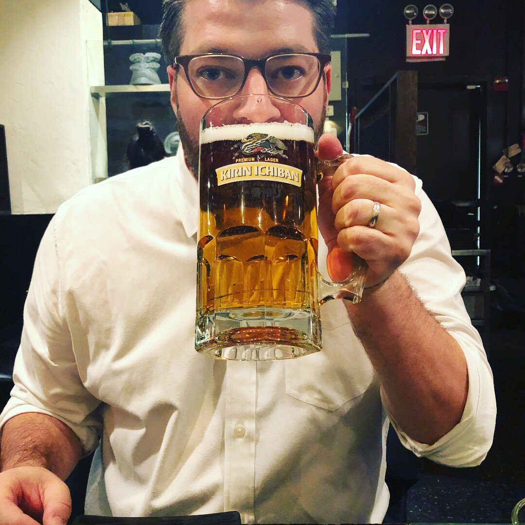 """Had to share this photographic luck. Hubby ordered the """"Mega Mug"""" beer. I took a pic, but literally one second later, the bottom of the mug FELL OFF, smashing to the table and spraying us both with a quart of beer. In the before pic, zoom in and see the crack in the glass. WTF."""