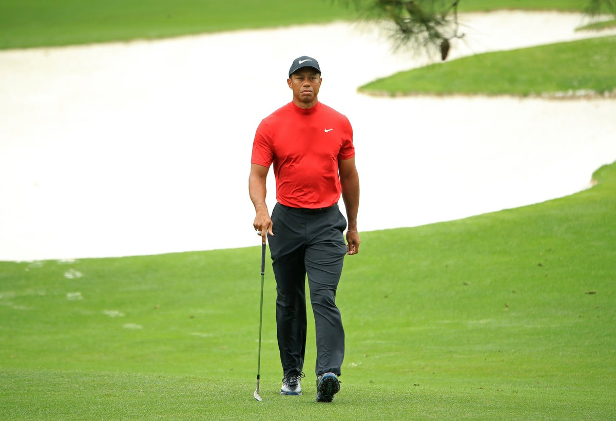 Red shirt.  Game face.  Tiger Woods.  #LiveUnderPar
