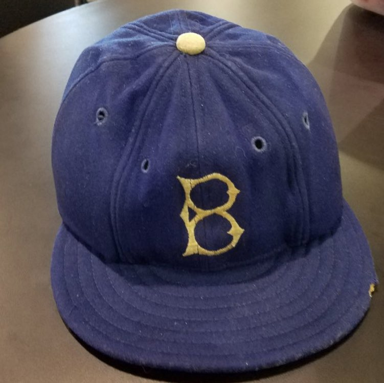 """It's not what we knew of Jackie Robinson that made him incredible. It's what we didn't know, including the death threat letters we never saw. This hat he wore his rookie year had three metal plates sewn into it to protect him from pitchers throwing """"beanballs"""" at his head. <br>http://pic.twitter.com/SYKgaJMM8t"""