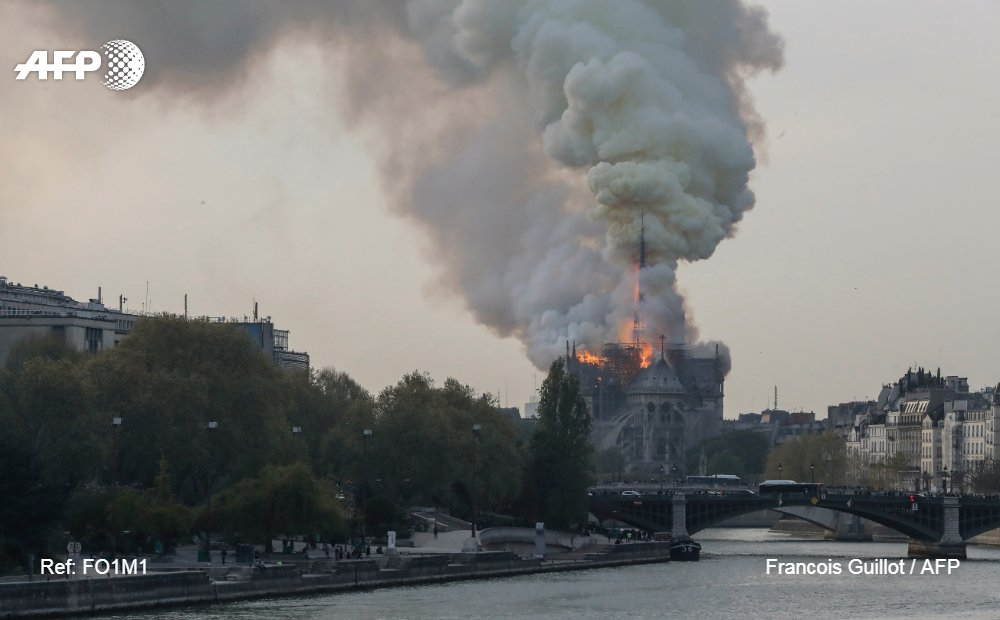 #UPDATE Smokes ascends as flames rise during a fire at the landmark Notre-Dame Cathedral in central Paris