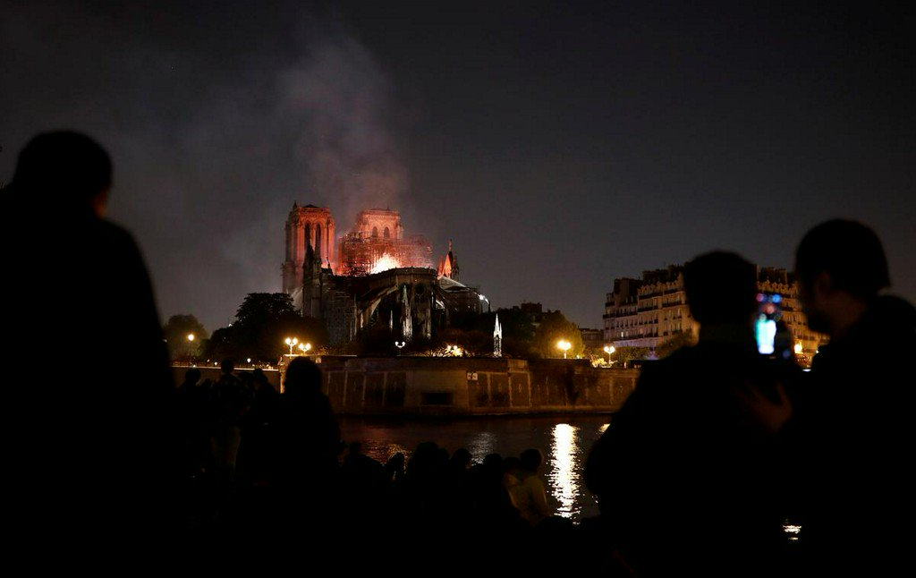 'City of lights' plunged into dark sorrow as Notre-Dame burns https://reut.rs/2IyyJ5K