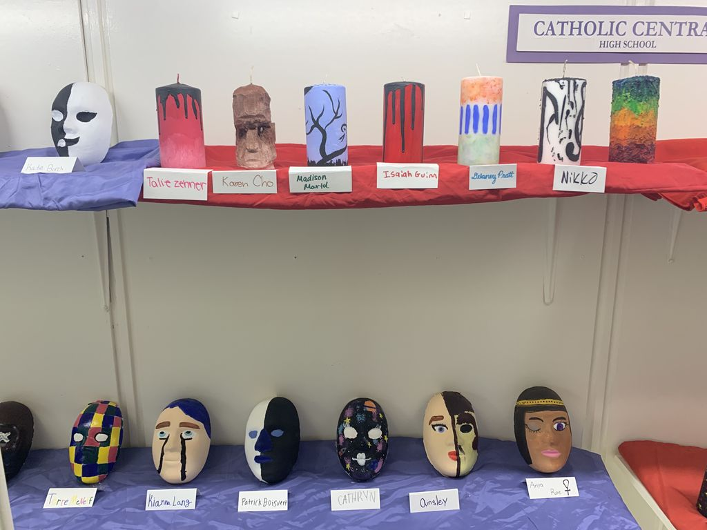 """Our """"Murphy's Little Masters"""" this week are students from Mr. Murphy's 7th grade art class and Studio in Art class. The 7th graders created these beautiful masks and the Studio in Art class created the detailed candles! Great work everyone!"""