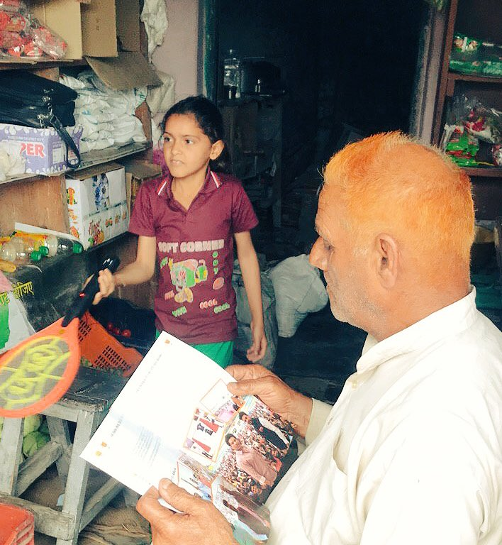 We stopped at a local store to find this person busy reading our achievements brochure!  #Hamirpur #Himachal #NaMoAgain<br>http://pic.twitter.com/raHr2wrv5I