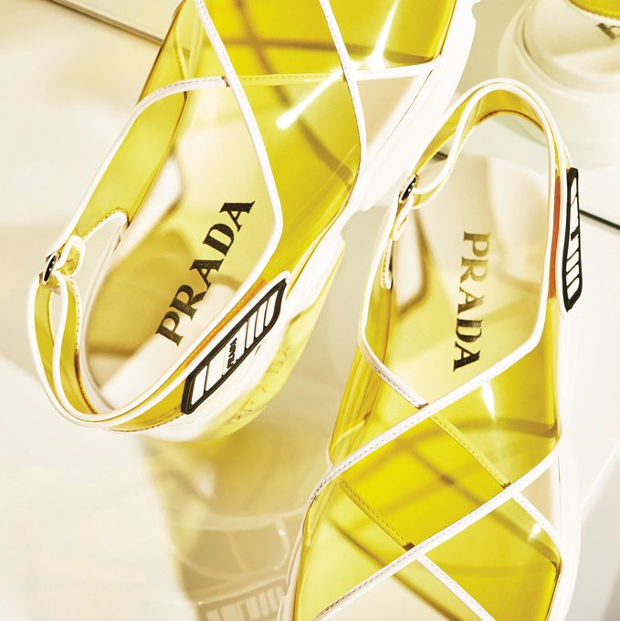 a72898d4a412 The newest member of the #PradaCloudbust family is a PVC sandal in  citrus-yellow. Discover more at tinyurl.com/yyrsduug. #Prada