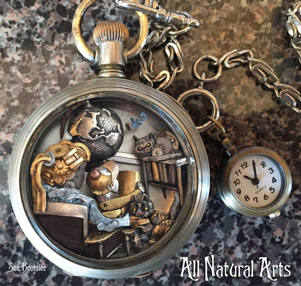 "Amazing watch part & pocket watch sculptures from Cliff Sea, NY based artist Sue Beatrice @allnatural_arts at https://t.co/6fiMjVApBi ""I Give You the World"", © Sue Beatrice #art #SueBeatrice #sculptor #SteamPunk"