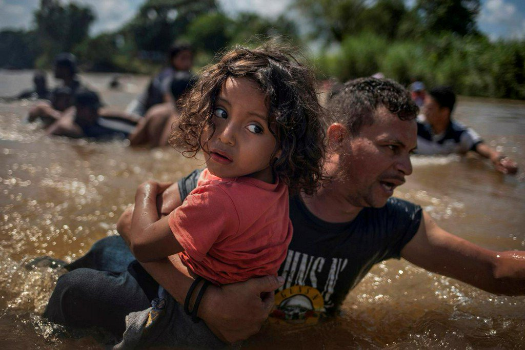 Backstory - From a dusty town to a flowing river: how Reuters photographers won a Pulitzer reut.rs/2IAQOQv