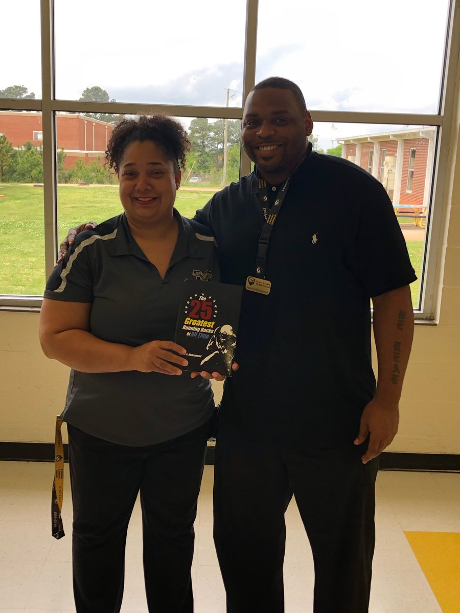 Mr. Muhammad gave Principal @ljswiggins a copy of his book! Not only do We Read ... We Write! Leaving a  Literacy Legacy! Best faculty and staff ever! #InPurpose #WarhawkPride<br>http://pic.twitter.com/uvX6FYCOjp