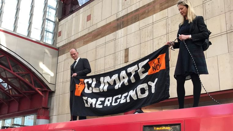 Climate change protesters mount train amid plan to 'disrupt' public transport // that's an electric train. Outside the high tech green offices of KPMG's climate change department, stopping their staff getting to work…   Top work guys    http://news.sky.com/story/climate-change-protesters-mount-train-amid-plan-to-disrupt-public-transport-11696014…