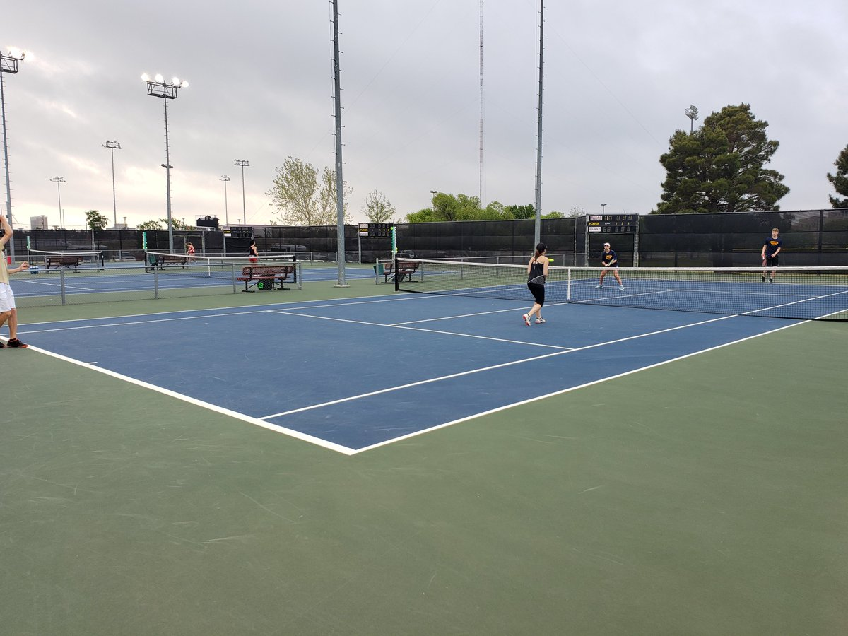 Arl. Heights competing in mixed doubles versus The Colony!