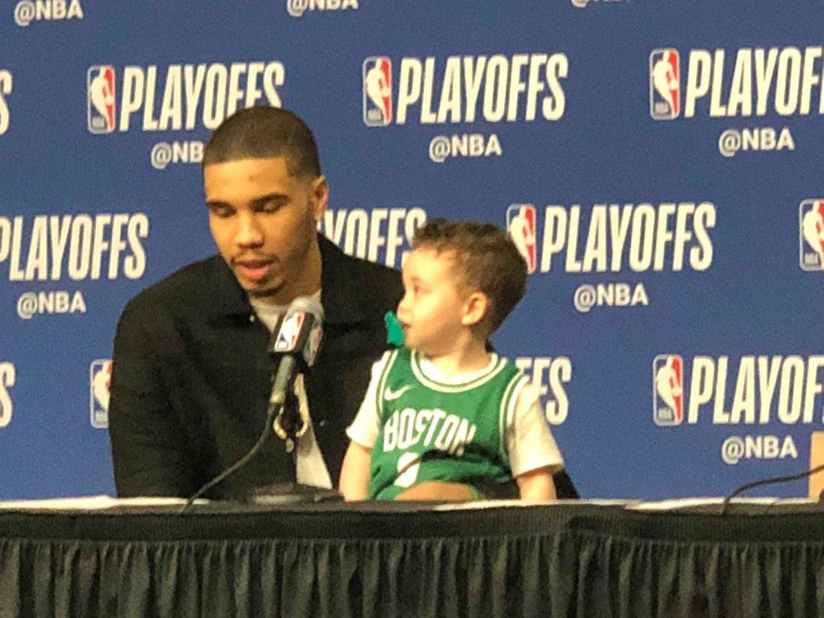 Jayson Tatum and his son Deuce at the podium.