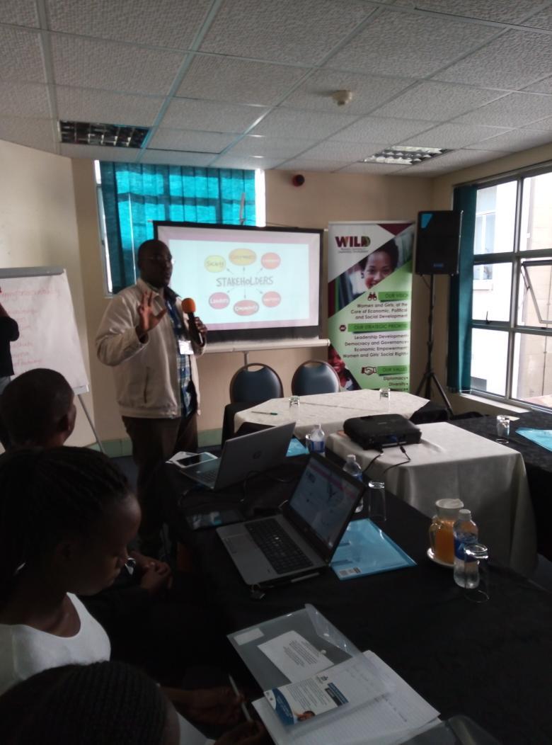 Thando Nkomo  @thando263nkomo   takes young women through a session on public relations and accountability during the #bloggingforaccountability training.