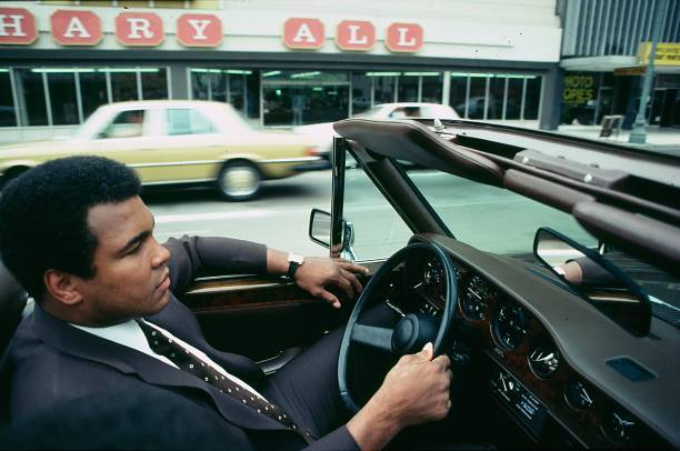 #ThrowbackThursday  #MuhammadAli drives his convertible #RollsRoyce around Los Angeles before his last fight with Larry Holmes. August 3, 1980 at the wheel of his Rolls Royce, Los Angeles, California.  © Photo by Paul Harris<br>http://pic.twitter.com/wNRXu8rbVf