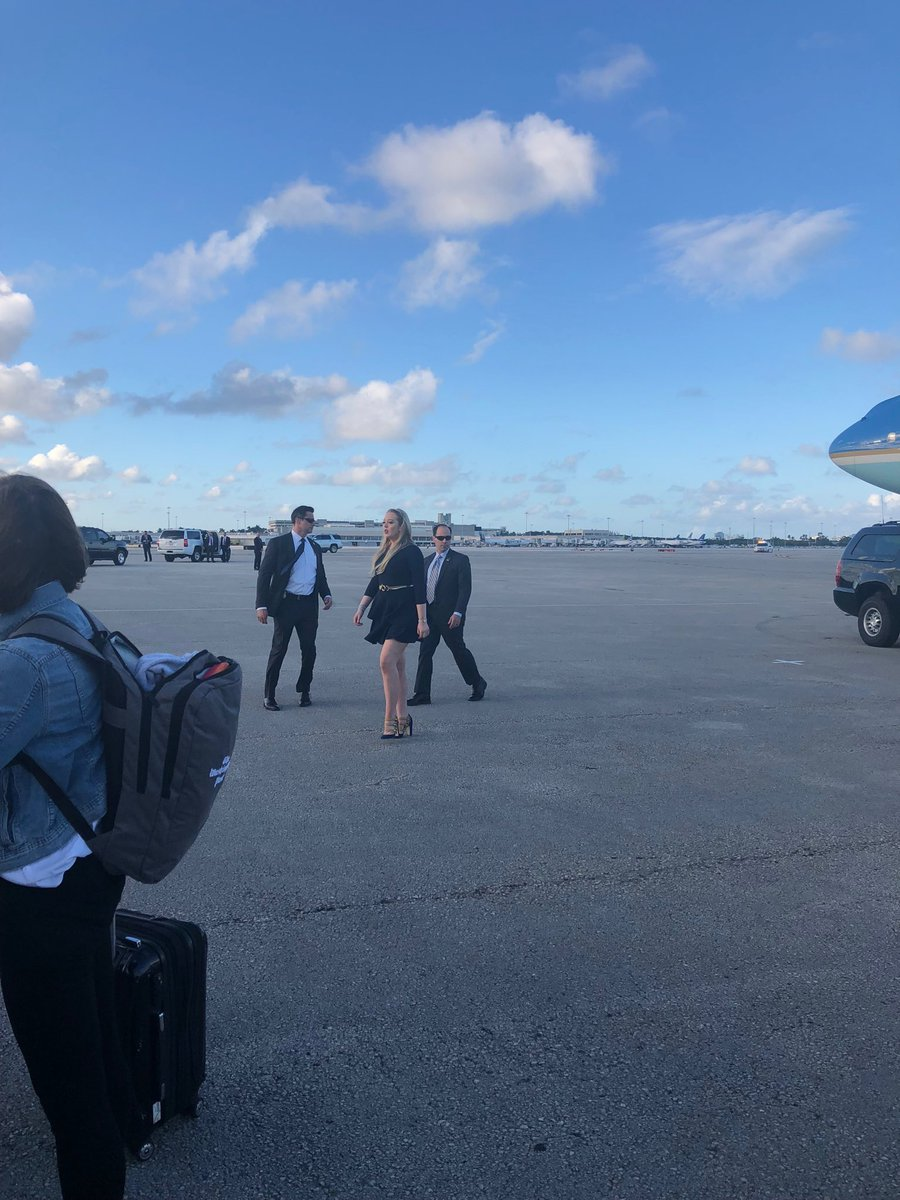Tiffany on the tarmac, going to greet supporters with her dad.