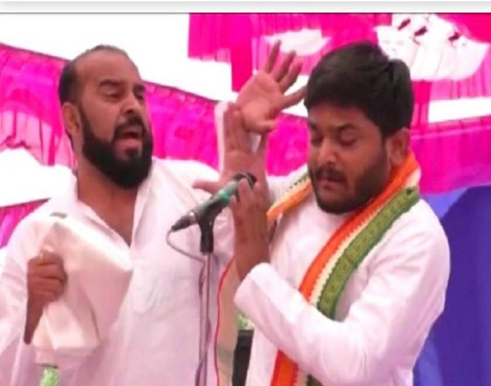 Man slaps Hardik Patel on stage during election rally in Gujarat