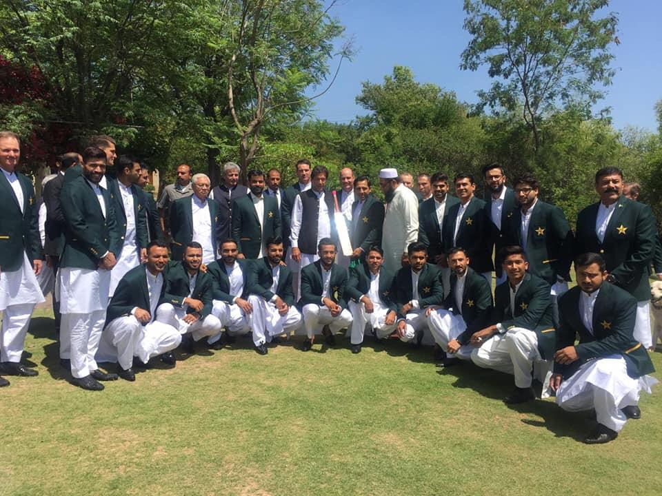 The Pakistan squad pose for a photo with their 1992 @cricketworldcup winning captain and current Prime Minister, Imran Khan.