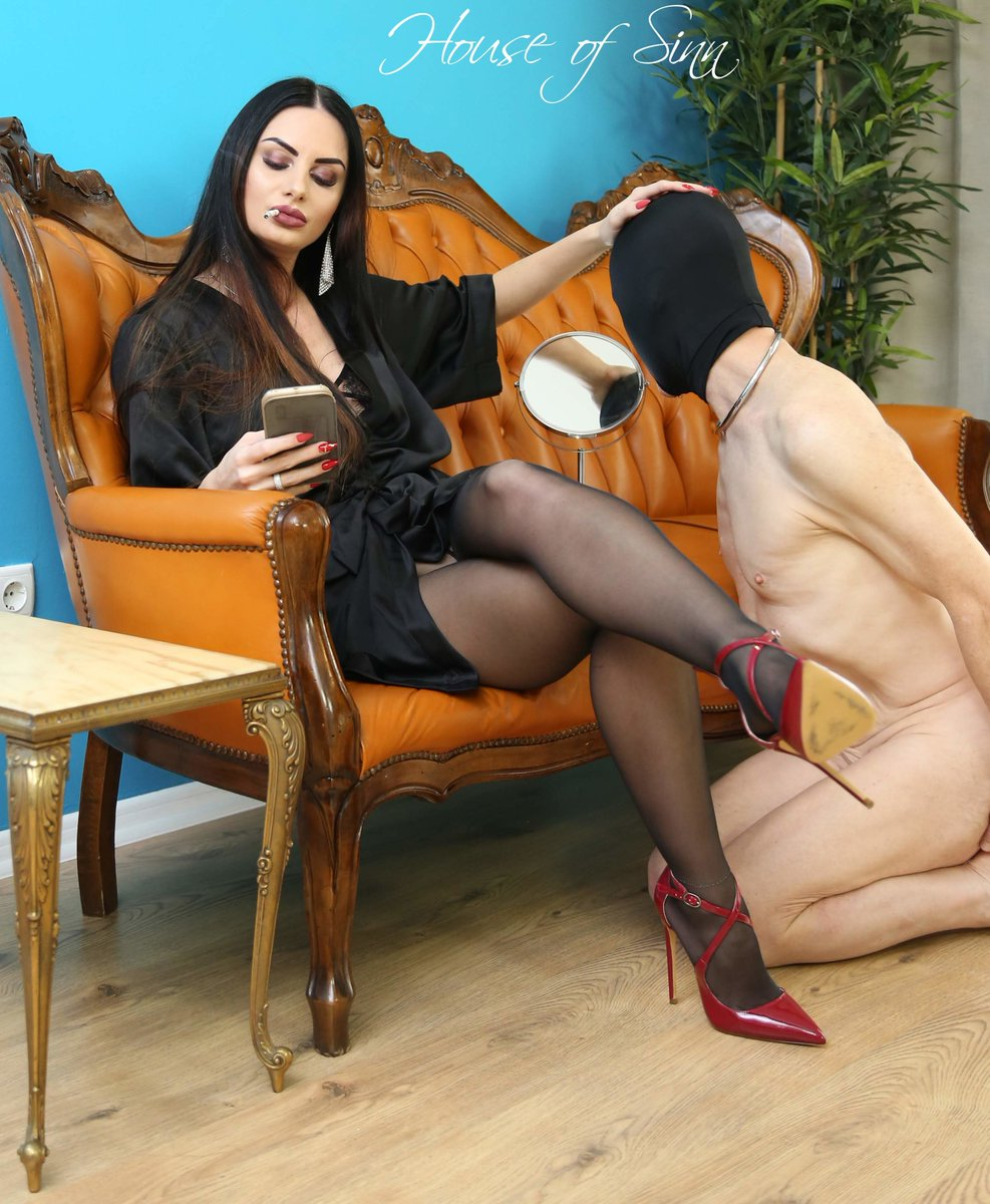 Femdom goddess dominates a nerd and forces him to worship her feet