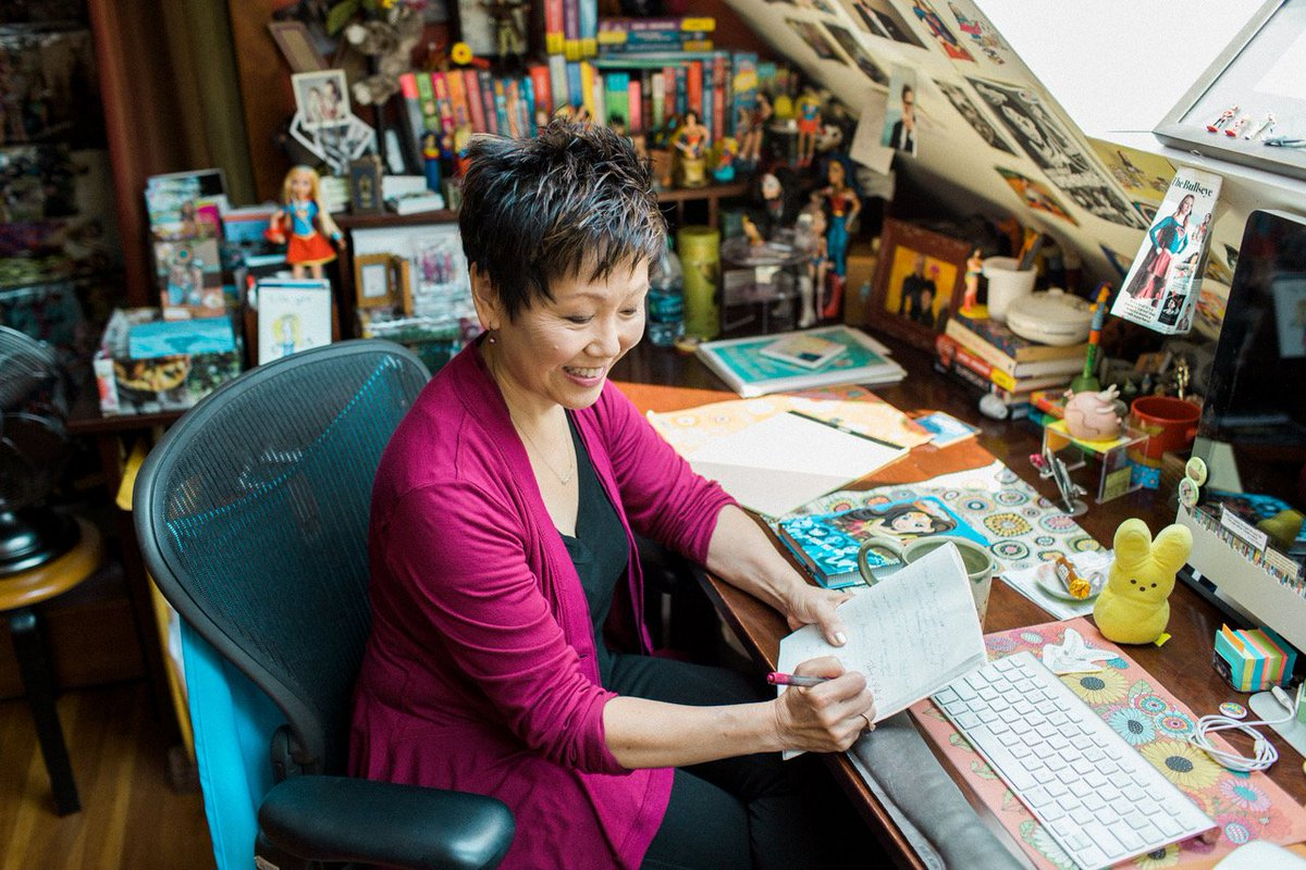 Lisa Yee at her desk in her office.