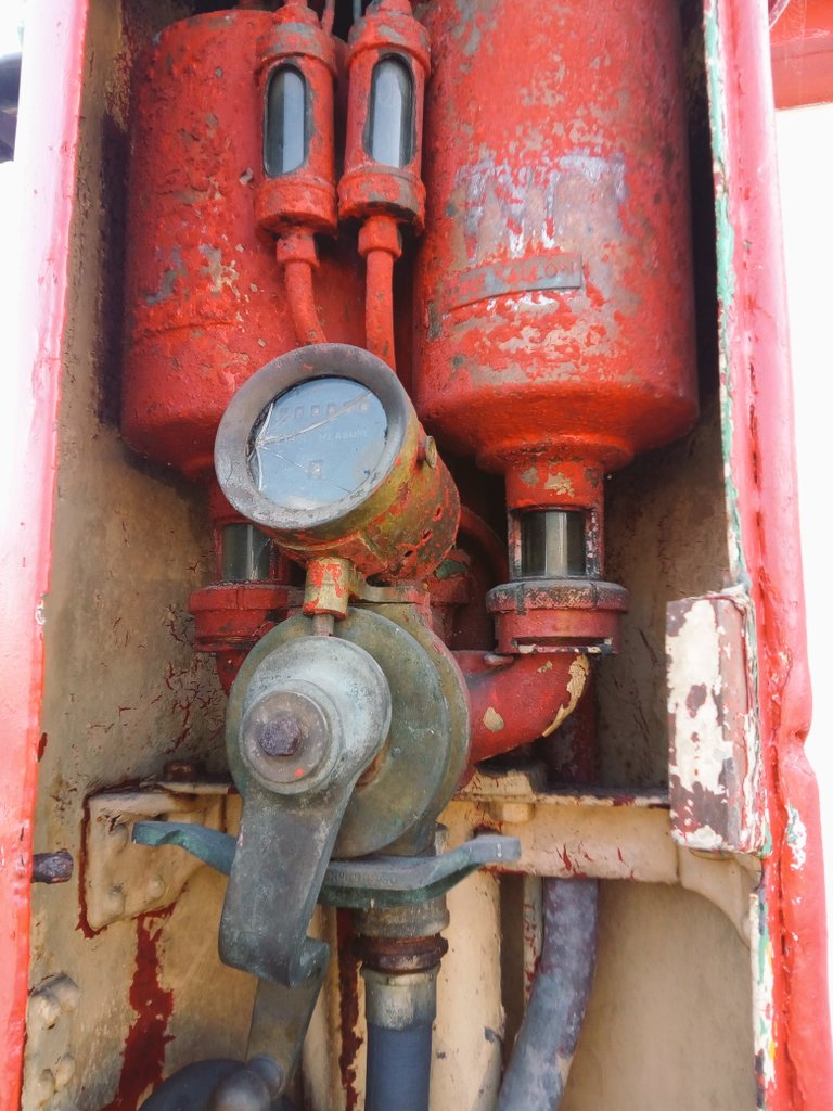 The innards of a vintage petrol pump which is positively #steampunk