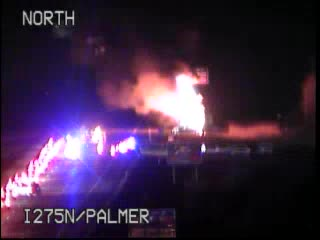 NB I-275 before Ford Rd...MDOT reports ALL LANES are BLOCKED as fire crews battle the flames...  Avoid the area at this time... #Traffic #Delays
