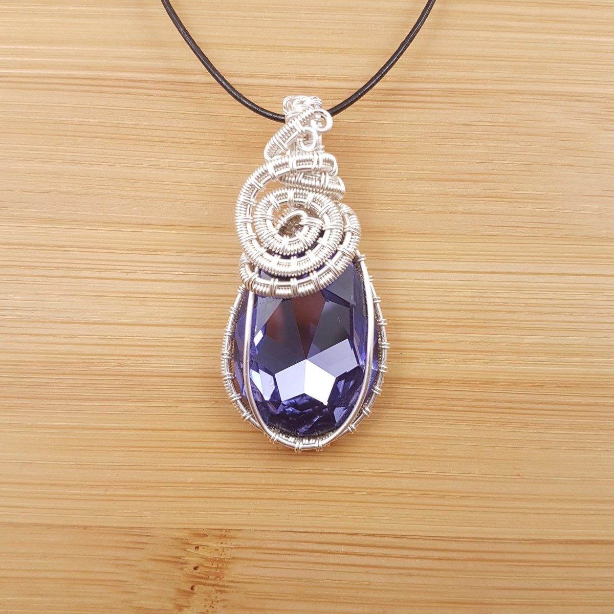 Light purple Swarovski drop pendant wrapped in silver wire