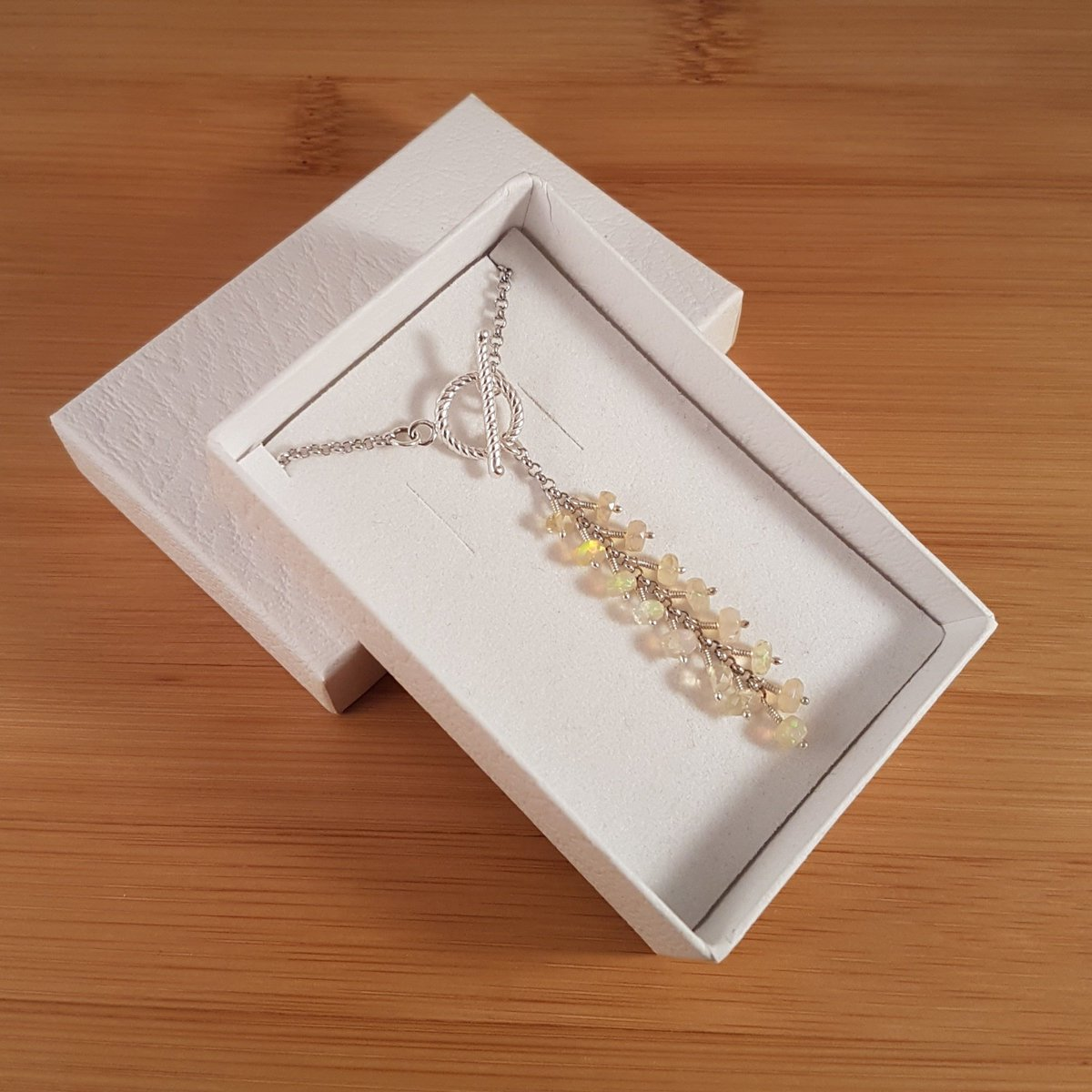 Opal cascade and silver T-Bar necklace in white box