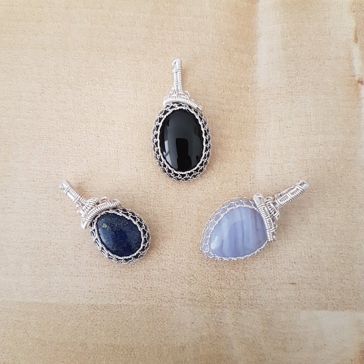 3 small wire wrapped stone pendants