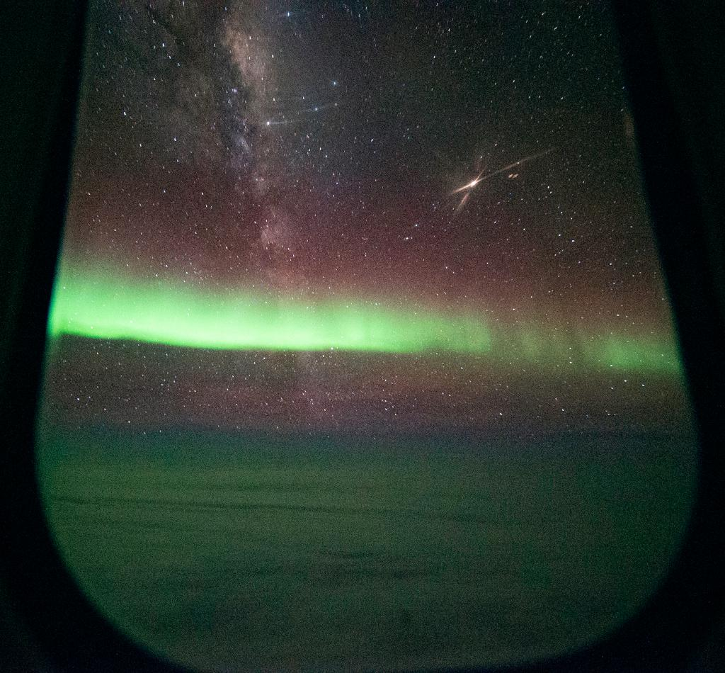 A view of the southern lights, or Aurora Australis, as we flew over the Southern Ocean last year. The Milky Way and Mars are also visible in this image taken at 43,000 feet. Share your #PictureEarth go.nasa.gov/2Gp5qjk