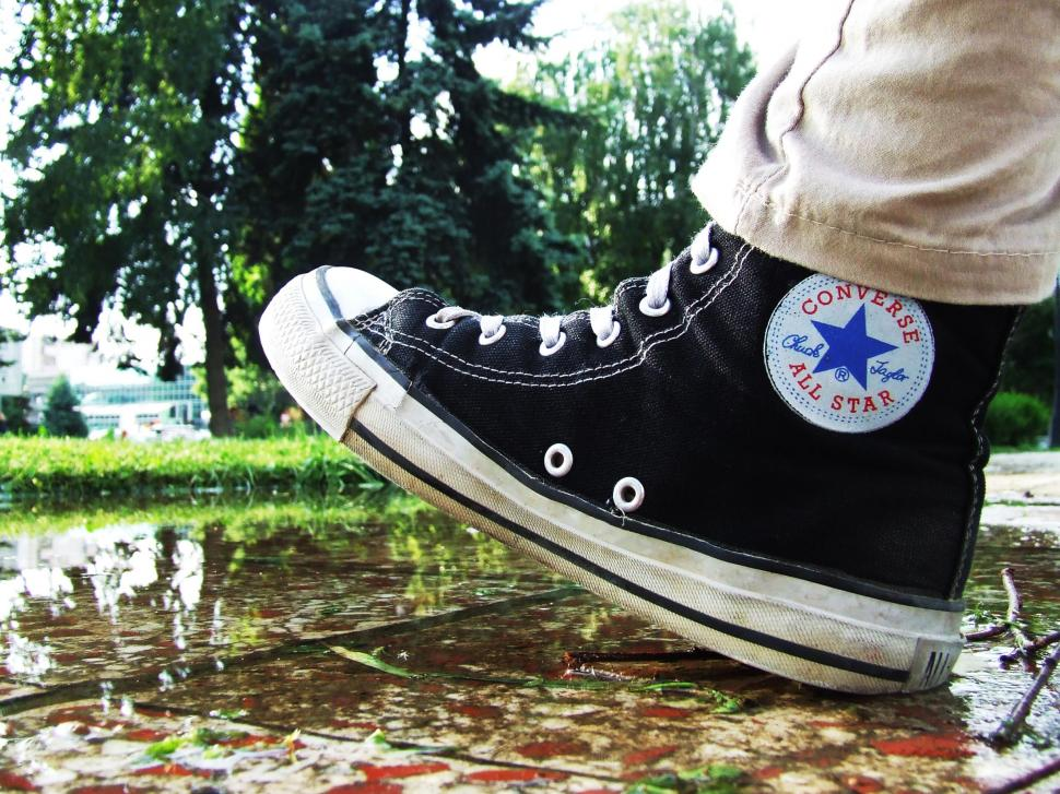 taking a step in a high-top sneaker