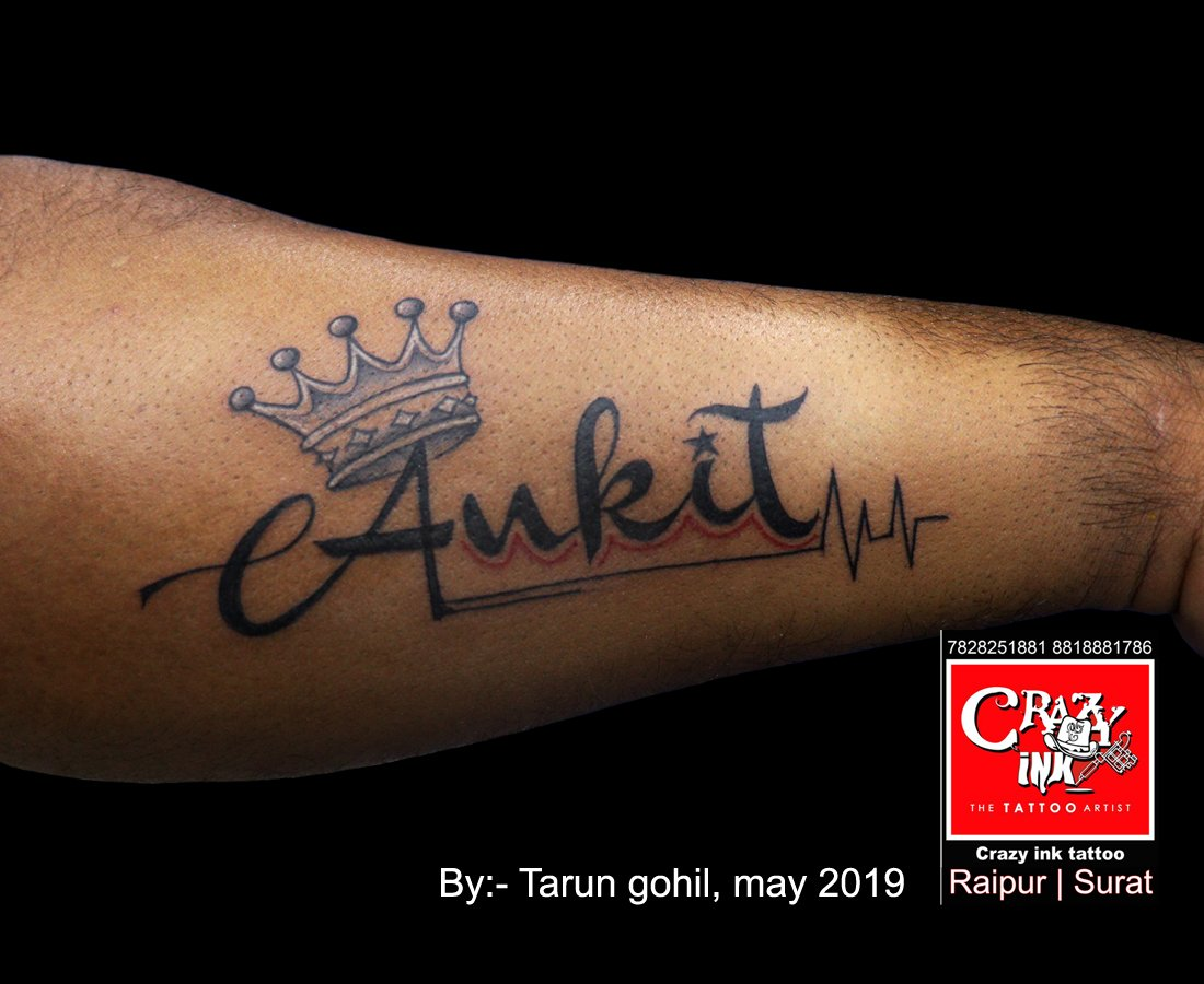 2ef4caccf Name and crown tattoo. Tattoo done by tattoo artist Tarun gohil. At crazy  ink