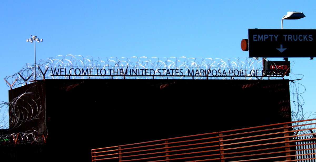 I got this photo of the Mariposa Port of Entry, in Nogales, from a reader, who found the razor wire a bit of a contradictory message to the words it's covering.