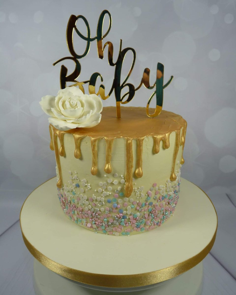 Gold Drip Baby Shower Cake with pink, white and blue