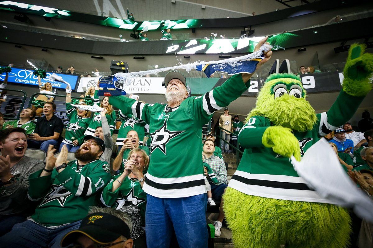 Dave from Fort Worth, our fan with the umbrella, ripping up the Blues rally towel he got at Game 5 in St. Louis! #GoStars   #StanleyCup