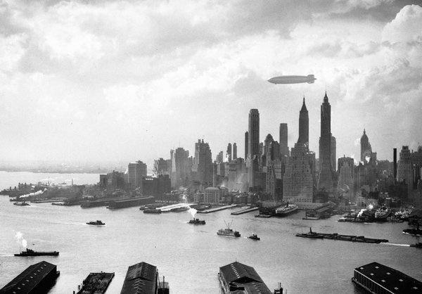 Hindenburg hovering over Manhattan--hours before disaster at Lakehurst, NJ, tomorrow 1937:  #AP
