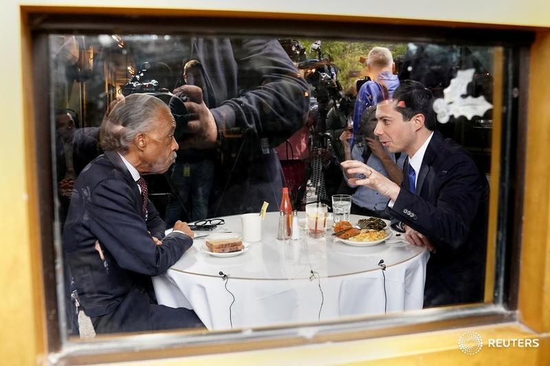 2020 Democratic presidential candidate Pete Buttigieg and Rev. Al Sharpton speak at Sylvia's Restaurant in Harlem, and more photos of the day: https://reut.rs/2XZ7CVX  📷 @carloallegri
