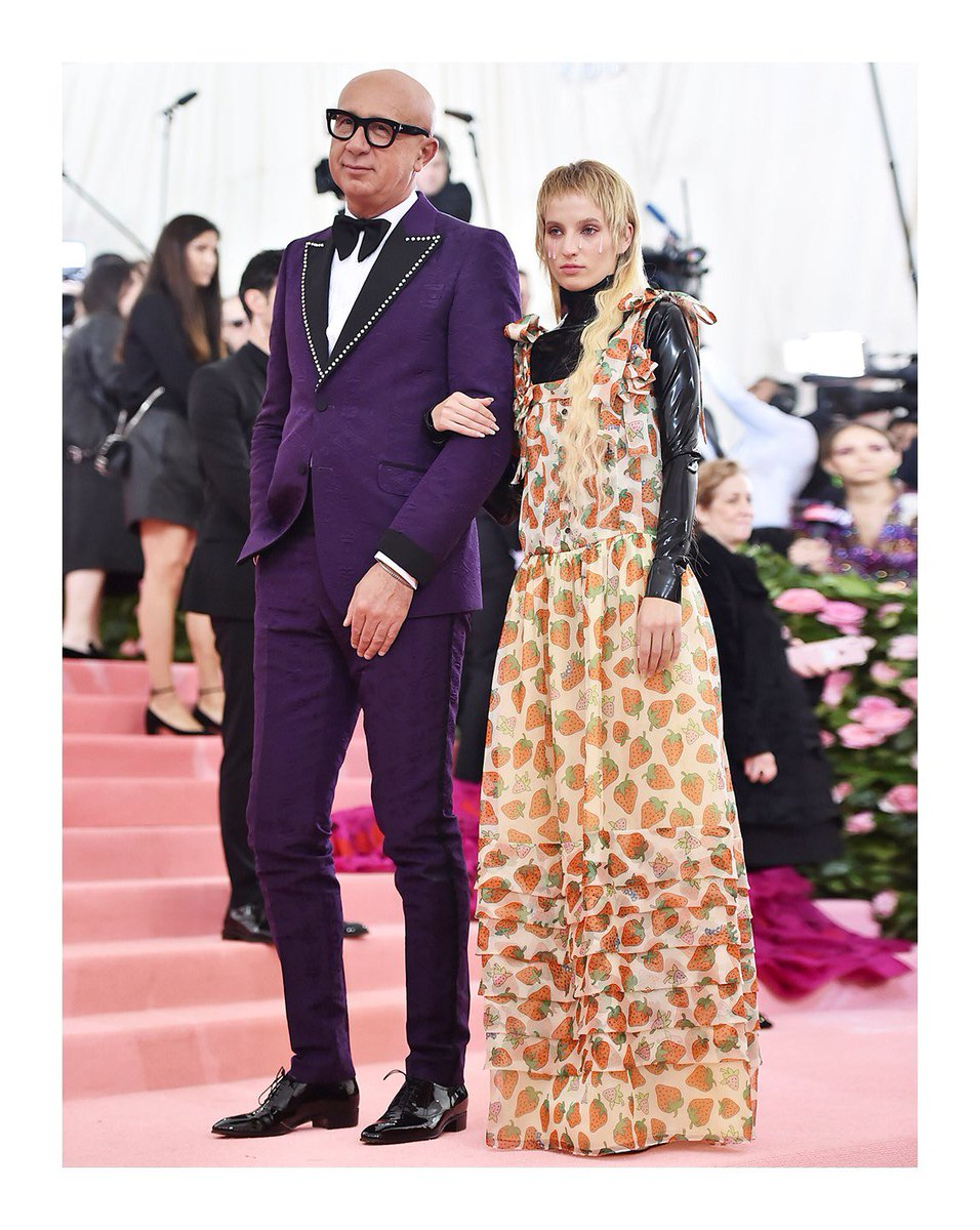 Captured together on the #MetGala @metmuseum Costume Institute pink carpet, @petracollins in a #GucciSS19 printed dress with latex bodysuit and #Gucci President and CEO #MarcoBizzarri. #GucciBeauty #MetCamp #MetGala2019
