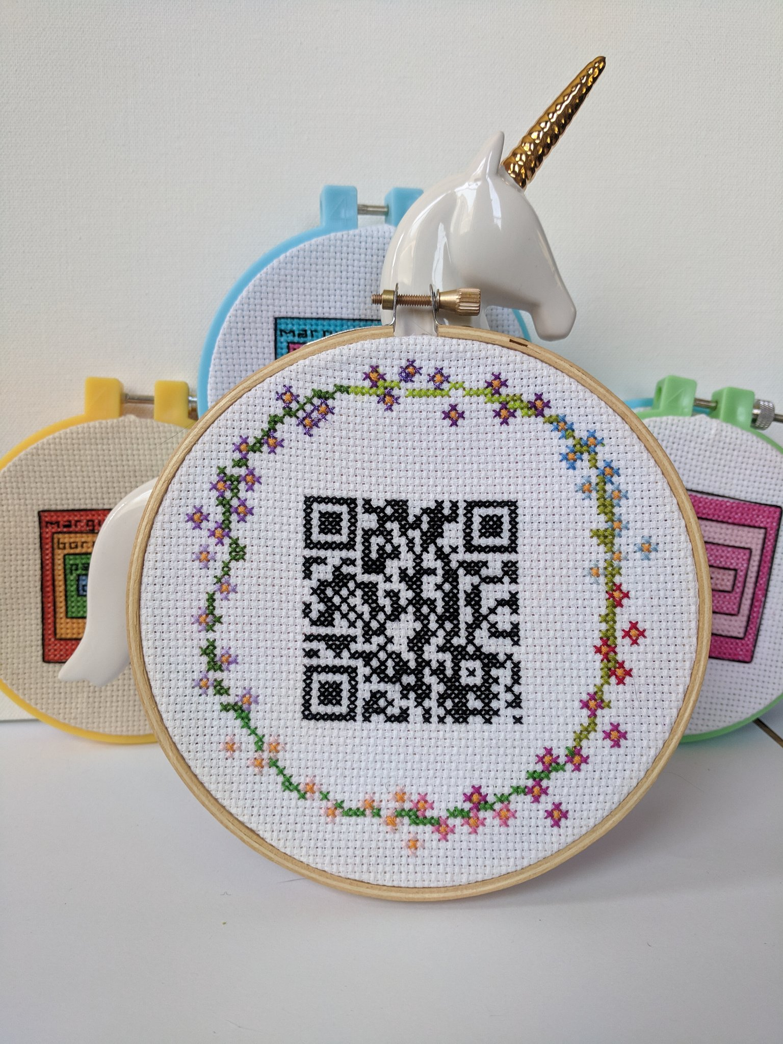 qr cross stitch in hoop, complete with spokesunicorn