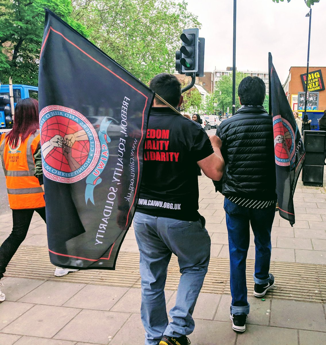 Now the @caiwuunion demo bus has reached the Lilian Baylis School in Kennington where cleaners are not paid a living wage. #MayDay