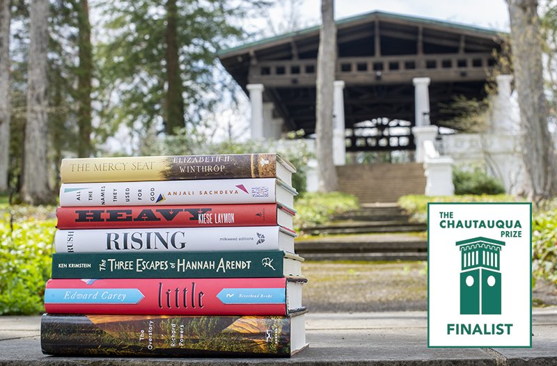 stack of 2019 Chautauqua Prize finalists in front of Hall of Philosophy