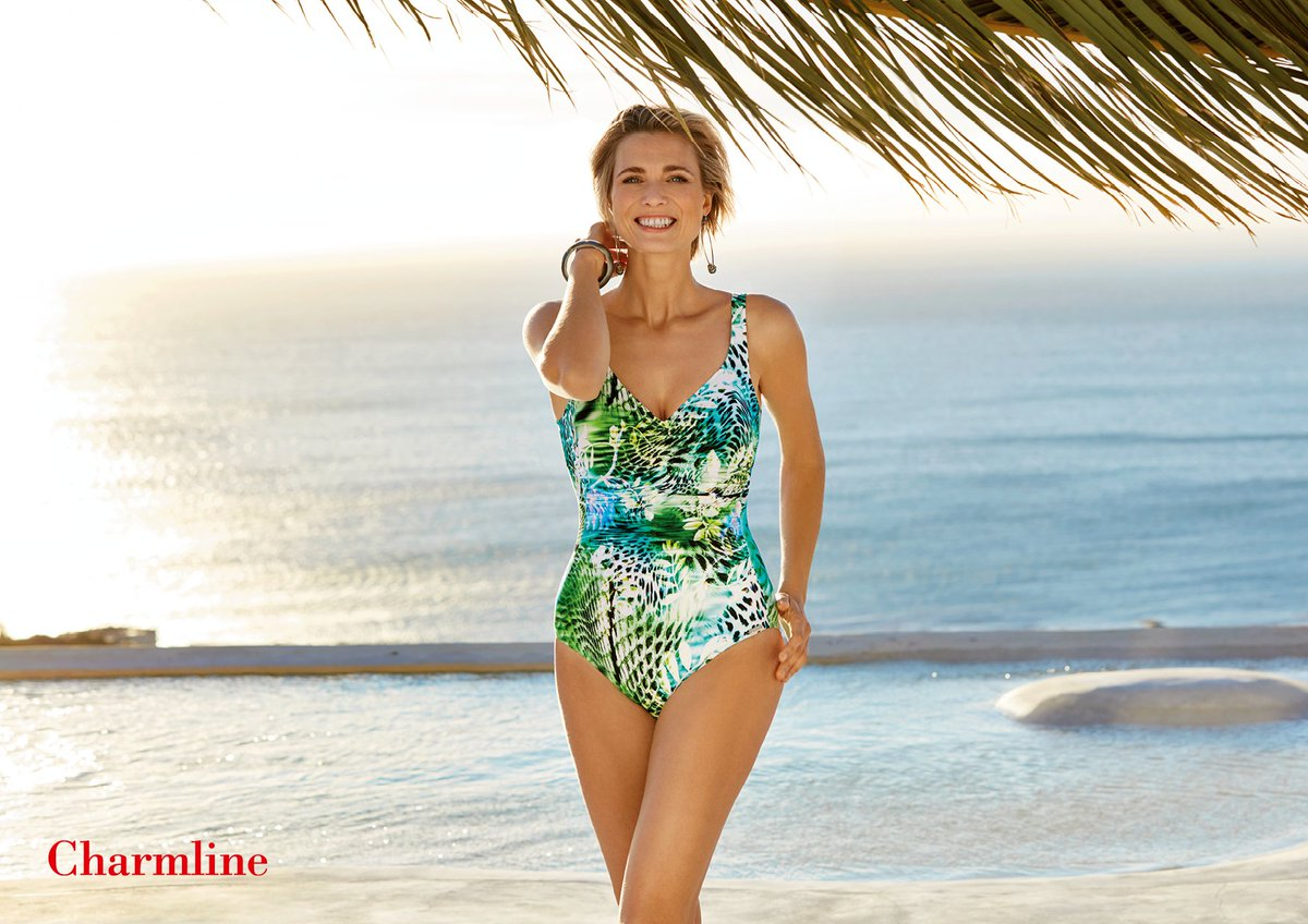 0480e913f38 Think exotic escapes with Charmline's Wildlife Waters Ruched Side Jungle  Swimsuit. This colourful jungle print