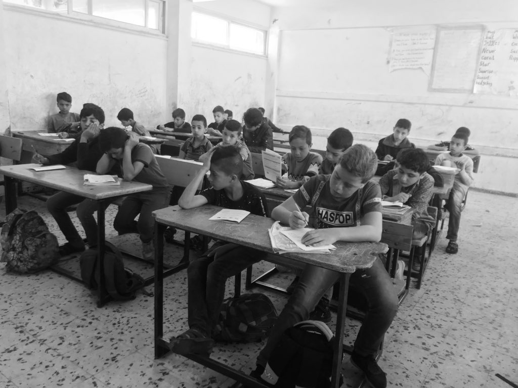 Took this photo from the class yesterday during the Israeli bombing.  They didn't scream, run, or hide. They are used to it. #Gaza