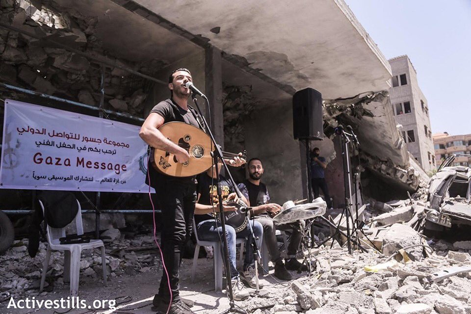 Palestinians in Gaza performing music over the rubble of a destroyed building, calling for a boycott of Eurovision  May 14, 2019 (pictures by Mohammed Zanoun) <br>http://pic.twitter.com/7YCSaiEllo