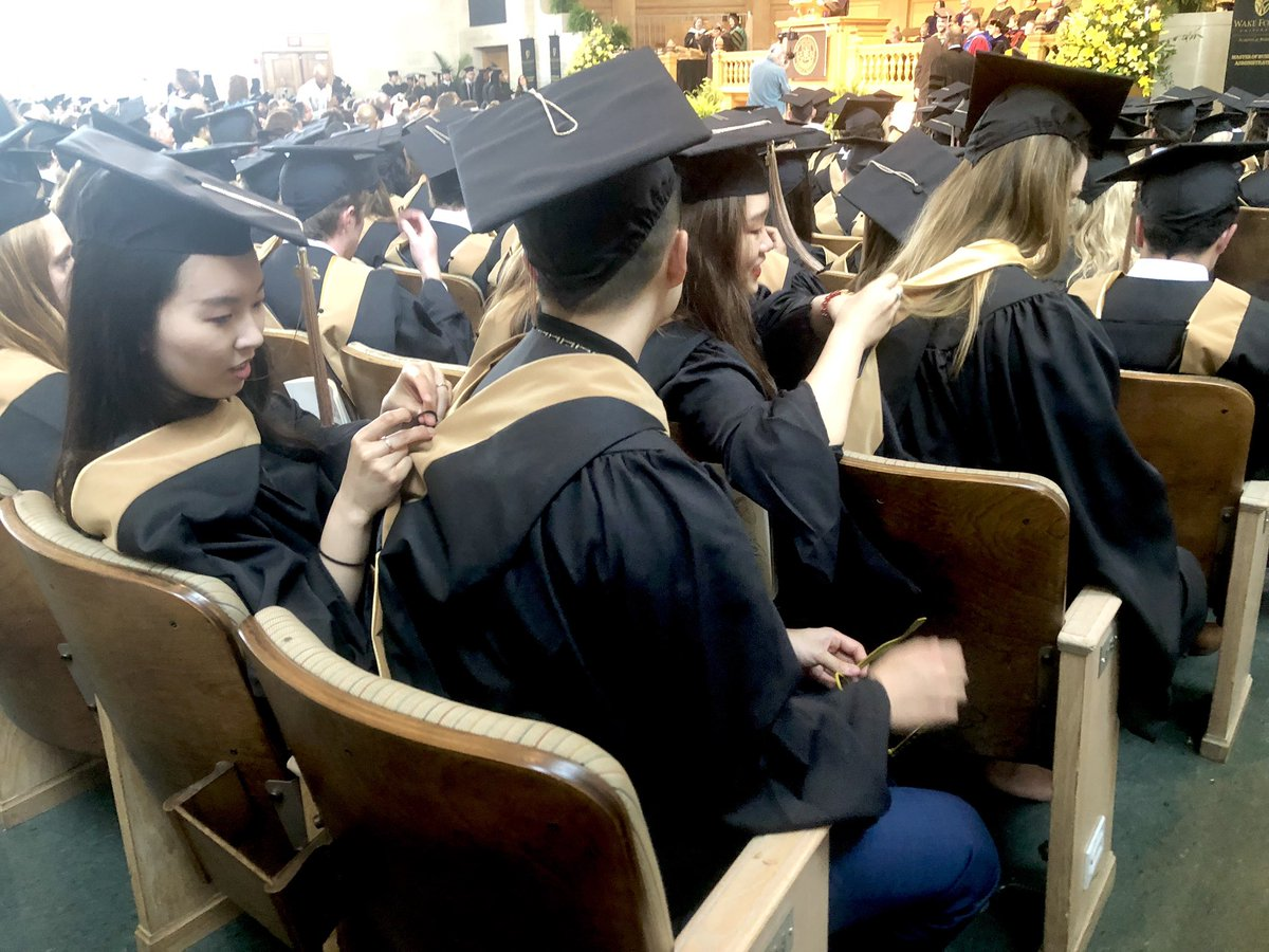 A little #ProHumanitate in the seats as the newest @WakeForestBiz MS in Accountancy @WFUAlumni help one another with their freshly acquired hoods 😃👍 #WFUGrad #GoodWearsBlack @WakeForest