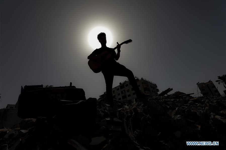 On the ruins of a residential building in the Gaza Strip destroyed by Israeli war jets, a group of Palestinian singers on Saturday sent out an anti-Israeli message to the Eurovision Song Contest being held in Israel.