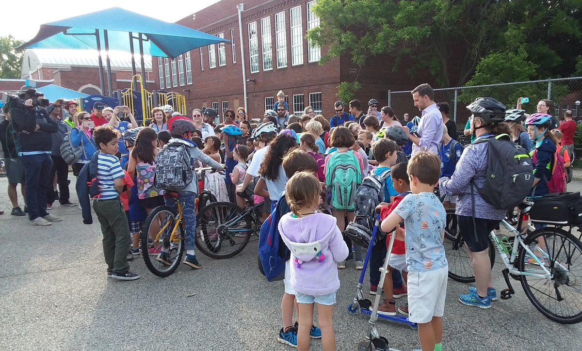 Student cyclists gather with bikes at ATS to appear on TV for Bike to School Day