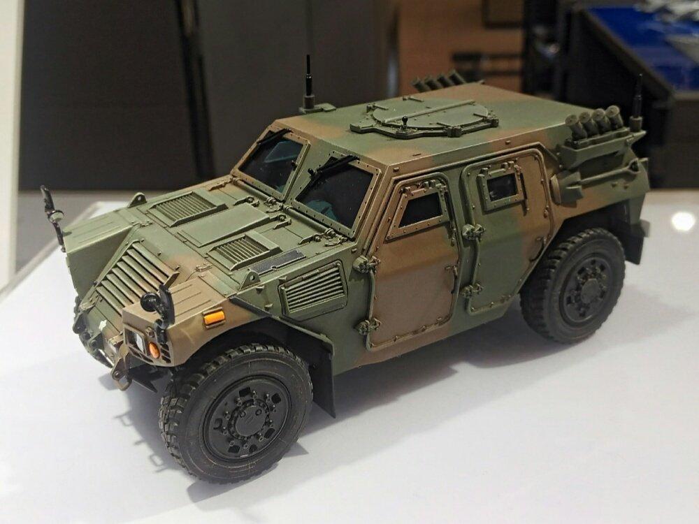 #静岡ホビーショー タミヤ新製品「1/35 陸上自衛隊 軽装甲機動車(LAV)(仮称)」。発売中のイラク派遣仕様に続き、細部に改良が施された国内仕様をモデル化。ドライバーのフィギュアが付属します。 #タミヤ